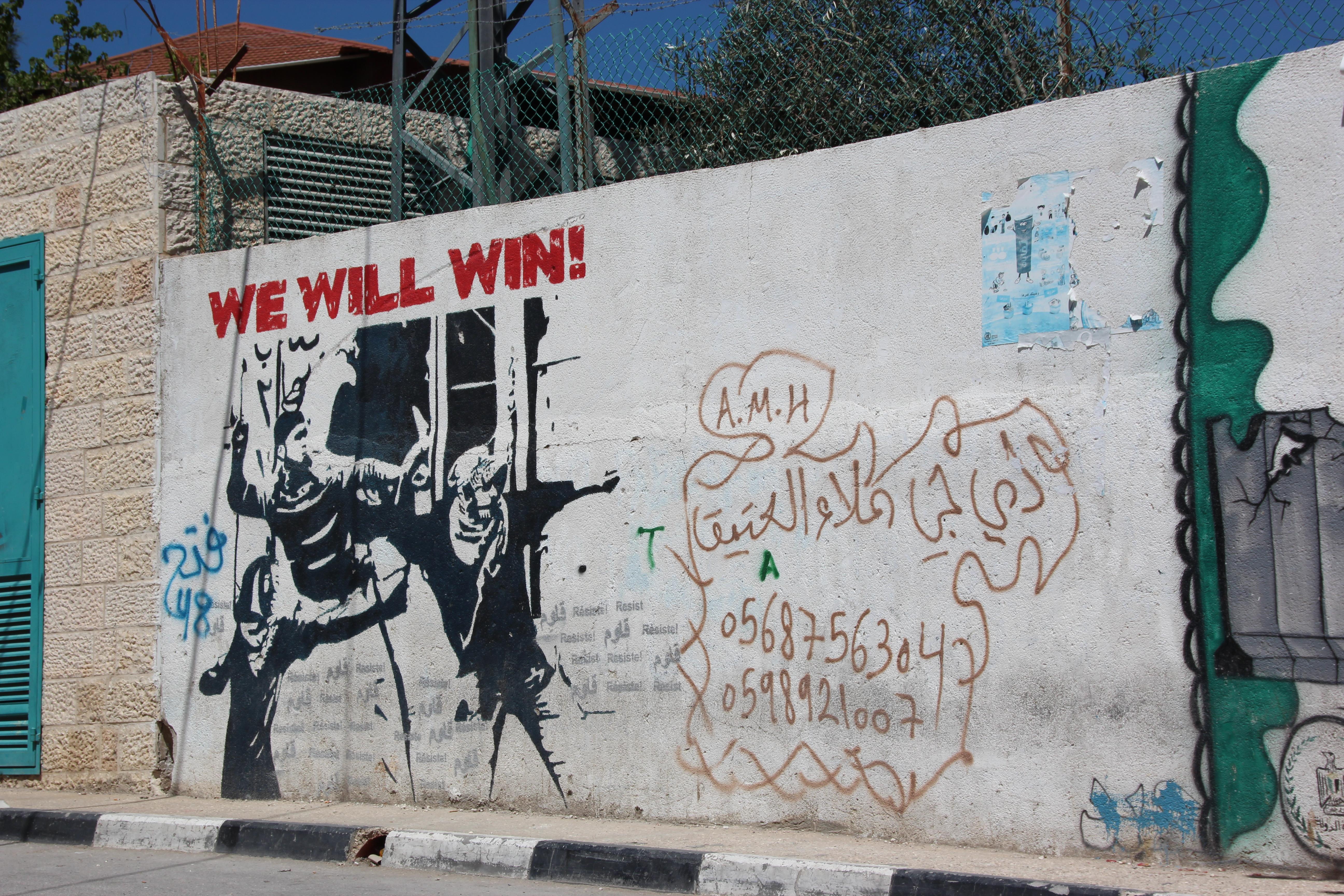 Grafitti på Vestbredden Foto: Reiselykke